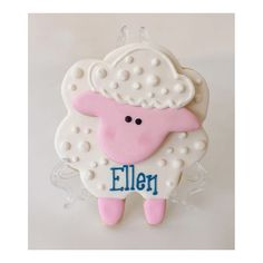Personalized lamb cookie on mini easel as place card for baby shower