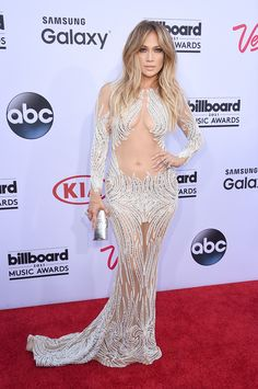 Jlo in Charbel Zoe HarpersBAZAAR.com OMG !! Get a grip alreeady and try another look !!
