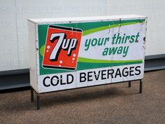 Salvaged 1960s tinplate sign with strong graphic & colours. Practical cabinet with 3 cupboards and 3 drawers.  created by: Rupert Blanchard  origin: Shoreditch, London
