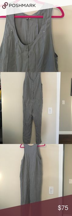 IRO silk jumpsuit IRO silver/blue silk jumpsuit. Can be worn belted, and so cute! Slash pockets in front, snap closure. Slight opening at ankle hem. Looser fit, to be worn belted. Skinny leg. So good to layer for fall! IRO Other