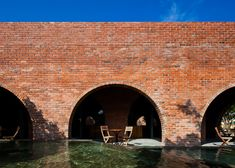 - F Coffee, the small brick cafe occupies a site near the airport in Dong Hoi, a city in Quang Binh Province. Brick Architecture, Contemporary Architecture, Architecture Details, Beautiful Architecture, Brick Cafe, Dong Hoi, Brick Archway, Wallpaper Magazine, Travel Wallpaper