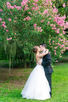 Bride + Groom Beneath Pink Crepe Myrtle | Colorful Turquoise, Pink + Orange Legare Waring House Wedding by Charleston wedding photographer Dana Cubbage Weddings