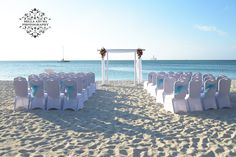 Turquoise like the sea sashes adorned on white chairs