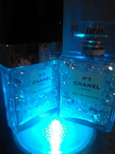 Original Channel Perfume Bottles .. (Mine I couldn't bear to throw away)... Recycled with swatrz diamonds inside and out from underneath..... Now have a great reason to hold onto them forever 🎆🎆🎆🎆