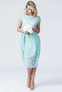Daniella Cristea Duchess Mint Dress, raised flowers, elastic held sleeves, short sleeves, one back botton fastening, back zipper fastening, nonelastic fabric