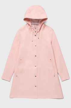 The Stutterheim Mosebacke Pale Pink raincoat is the women's A-line version of our iconic raincoat. This feminine model has a beautiful silhouette with a spacious cut. It is handmade in rubberized cotton, comes unlined, with double welded seams, snap closu Pink Raincoat, Raincoat Jacket, Hooded Raincoat, Vest Jacket, Rain Jacket, Raincoat Outfit, Raincoats For Women, Jackets For Women, Clothes For Women