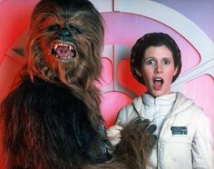 Princess Leia goofing off and getting frisky with Chewbacca behind the scenes