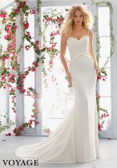 Wedding Dresses By Voyage featuring Crystal Beaded Straps Support the Asymmetrically Draped Bodice on Lush Crepe Colors available:White/Silver, Ivory/Silver.