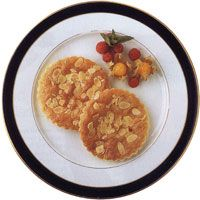 """""""Almond Cakes.  The cake and pastries made in Spanish convents are famous for their delicacy, the result of careful preparation and traditional methods. Many of the recipes, a legacy of the Arab presence in Spain, wisely combine almonds with honey and eggs and were brought to the convents by nuns who had learned them in their homes...  The following recipe comes from a Granada convent and is said to be a secret, but we happen to know it is included in a well-known publication."""""""