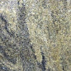 JUPARANA GAIVOTA IPANEMA. Diagonal swirls of black and brown on a soft creamy background. Gorgeous granite color available at Knoxville's Stone Interiors. Showroom located at 3900 Middlebrook Pike, Knoxville, TN. www.knoxstoneinteriors.com. FREE Estimates available, call 865-971-5800.