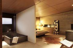 Loft bedroom, concrete tub, open bathroom