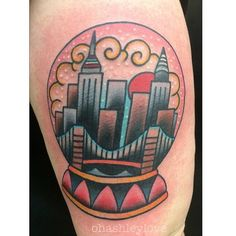 Snowglobe tattoo by Ashley Love at New York Adorned. She managed to fit the Empire State Building, Brooklyn Bridge and the Crysller Building. I couldn't be happier :)