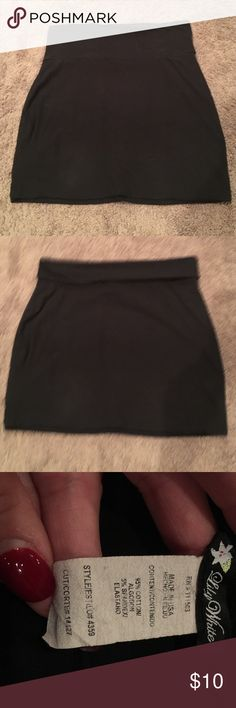 Black mini skirt Super cute and comfy black mini skirt. 95% cotton 5% spandex. Can fold over top of skirt for a different look. Can dress up or down. Lily White Skirts Mini