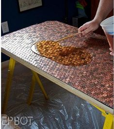 This would be a great idea to refinish an old table to be used outdoors.... http://www.apartmenttherapy.com/this-desk-makes-a-lot-of-cents-128337: