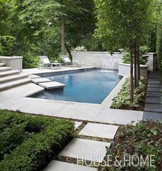 Cast-concrete walls and decks surround this angular backyard pool. | Photographer: Virginia Macdonald