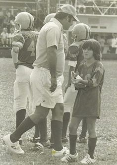 Dad coaching the Falcons, me as water girl. Sometime in the 70's.