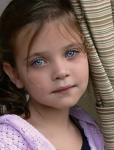 Beautiful young girl with hauntingly sad eyes.