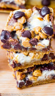 Peanut Butter S'more Layer Bars! 7 layers of s'more and peanut butter goodness. This dessert is dangerously simple to make!