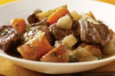 Make this Easy Slow-Cooker Beef Stew and come home to the savory aroma of a ready-to-eat dish. Our Easy Slow-Cooker Beef Stew is sure to become your new favorite go-to recipe. Easy Beef Stew, Beef Stew Meat, Slow Cooker Beef, Slow Cooker Recipes, Beef Recipes, Cooking Recipes, Bbq Beef, Beef Broth, Crockpot Meals
