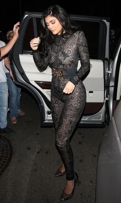 Kylie Jenner couldn't go out in her birthday suit for her early b-day celebrations last night. So she wore the next closest thing: a black lacey naked jumpsuit.