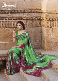 This green colored georgette saree with bunch of flower's prints , Nice one!