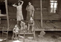 Summer 1936. Children of sharecropper Frank Tengle at their Hale County, Alabama, cabin  by Walker Evans.