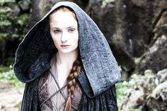 Sansa Stark - the northern-style cross-chest harness style cloak.... but not with leather like the men (and Arya) or embroidered bands like Catelyn, but fine cord and an extremely full hood instead.