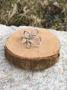 This fun and minimalist ring was handmade with sterling silver wire and exhibits a beautiful open profile and organic combined shapes. Each ring