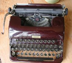 Isn't she beautiful? How I'd love to have her. Vintage 1939 Smith Corona Portable Maroon Red Typewriter