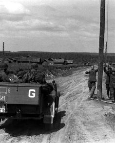 A Kfz. 15 medium cross-country personnel carrier from the Das Reich Division move past Red Army prisoners during Operation Barbarossa, area of Smolensk in the summer of 1941. The white letter 'G' indicates it belongs to Panzergruppe Guderian.