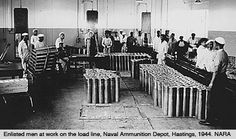 Loading line at Hastings Naval Ammunition Depot.Hastings was the site of the largest Naval ammunition plant in the country. At its peak in 1945, the Hastings Naval Ammunition Depot (NAD) employed over 10,600 civilian and military personnel – twice as many as the Grand Island plant. Hastings began as a smaller community than Grand Island, only 25 miles to the north. So, the impact of the Naval Depot on Hastings was much more intense. The first impact was on the land itself. The Hastings Naval…