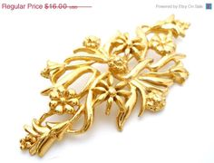 Vintage Monet Flower Brooch Gold tone Measures 2 3/4 x 1 1/4  Excellent condition Signed Monet  To find more pieces of fabulous jewelry, you