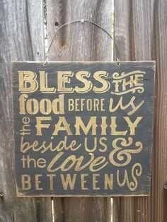 Bless the food before us, the family beside us and the love between us sign. Hand painted to look rustic on a 12x12 outdoor grade plywood.