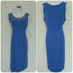 """HP NWT Michael Kors studded dress Pale blue Michale Kors dress with a beautiful studded neckline. There are no rips or stains. Perfect for a casual look when paired with sandals.   Measurements: Shoulder-shoulder = 14"""" Pit-pit = 19"""" Waist = 36"""" Shoulder-bottom = 36"""" MICHAEL Michael Kors Dresses"""