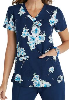 Get in the mood for spring with the beautiful Blueberry Flower v-neck scrub top from the popular Grey's Anatomy collection! Scrubs Outfit, Scrubs Uniform, Work Uniforms, Nursing Uniforms, Nursing Career, Nursing Clothes, Nursing Scrubs, Healthcare Uniforms, Cute Scrubs
