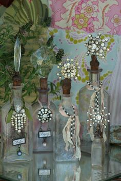 very pretty bottles with handmade stoppers made using vintage rhinestone jewelry and chandelier crystals. altered bottles # bottles with jewelry Altered Bottles, Antique Bottles, Vintage Bottles, Bottles And Jars, Glass Bottles, Vintage Perfume, Bottle Lamps, Perfume Bottles, Antique Glass