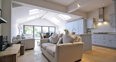 vaulted ceiling and roof lights really adds to the sense of space this extension has created. I searched for this on /images Open Plan Kitchen Living Room, Kitchen Dining Living, Kitchen Family Rooms, Open Plan Living, Dining Room, Bungalow Extensions, House Extensions, Kitchen Extensions, Style At Home