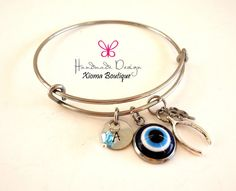 Evil Eye Bangle Bracelet/ Wish Bone  Four Leaf by XiomaBoutique
