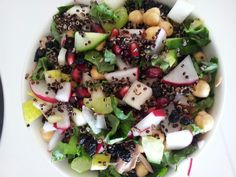 Radish, pear, kale, chickpea, dried currants, cucumber, celery, tuna, pomegranates and quinoa