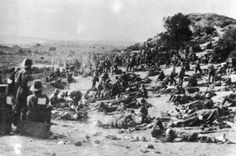 Wounded soldiers lying on a rise between North Beach and the later site of Commonwealth War Graves Commission, Canterbury Cemetery, near Anzac Cove, Gallipoli. Photographed 7 August 1915 by an unknown photographer.