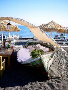 Seaside Restaurant Santorini, Greece Perivolos Beach near Perissa Beachside boat table