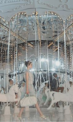 A favourite runway concept of mine- Louis Vuitton SS12 featuring a carousel and Kate Moss.