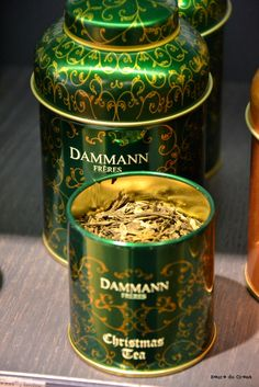 Dammann Frères [Dammann Freres]  Christmas Tea tea tin ... gold on green scroll pattern on round canister shape with sloping shoulders and cap lid, c. 2010s, France