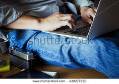 Man's hands using laptop for relaxation at home top view. Vintage tone.