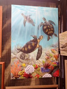 """On wall behind vanity.  Artist is Don J Dye - 360-384-5298.  Sea Turtles (""""Turtle Reef""""). See business card in small orange sparkly note binder in Condo black bag. Janet- cell # 360-303-0901  Can make in any size. The one I saw on display was 24x36. $269 if pick up at wooden boat show in Olympia in mid May Don would probably give me a discount.  NEED 3 week lead time to have ready."""