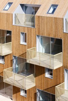 Square Court by Atelier Du Pont, located in Bondy, France. 34 Social housing units are arranged so the balconies are in staggered rows to the views on the street front or to the internal courtyard.