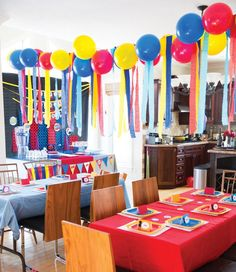 red, blue and yellow balloon and streamer garland