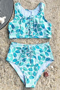 Enjoy one more wonderful travel to the sea! Take this lovely bikini set with you and go now~ So many unique details make it adorable: lace-up & high-waisted bottom. Fresh and chic. Shop Now!