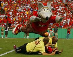 Kansas City Chiefs mascot KC Wolf piles on with security to subdue an onfield intruder.