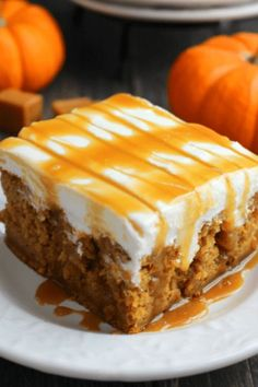 Pumpkin Caramel Cream Cheese Poke Cake from Delightful E Made is #7 on our list of the Best Pumpkin Dessert Recipes - The ultimate fall dessert! This pumpkin poke cake is drizzled with caramel sauce, frosted with a fluffy cream cheese frosting and topped with even more caramel sauce! You'll love every single morsel of this uber moist, delicious pumpkin cake!